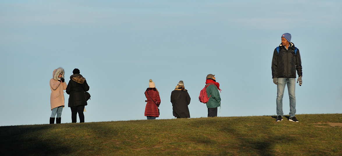 Taking in the view at Calton Hill. An image from the edinburgh photography book Seven Hills by Richard Flint